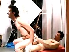Young guys having sex in art studio