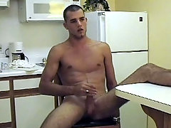 Cute next door guy stroking is sweet cock on the couch