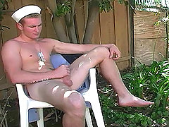 Sexy blond sailor stud masturbating his horny cock outside