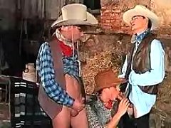 Teen cowboys enjoy oral